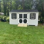 Shed outdoors in Long Island with A-Frame roof.